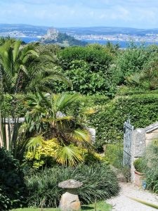 exotic palms in the ednovean farm gardne with views to st michael's mount