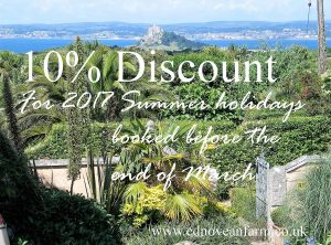 lush sub tropical garden with St Michael's Mount beyond with text 10% discount offer