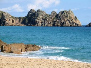 Cornwall holidays blue sea and golden sands at Porthcurno