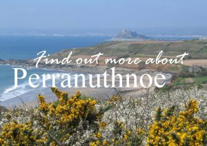 View from the coastal path to Perranuthnoe sandy beach in spring time with may and gorse flowers