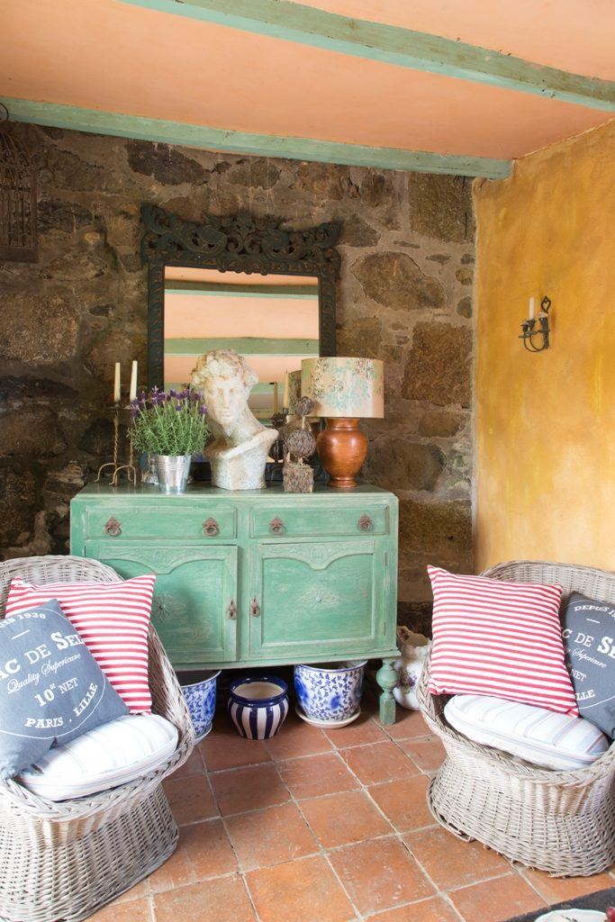 Paint finishes and ecletic objects decorate he garden room at Ednovean Farm