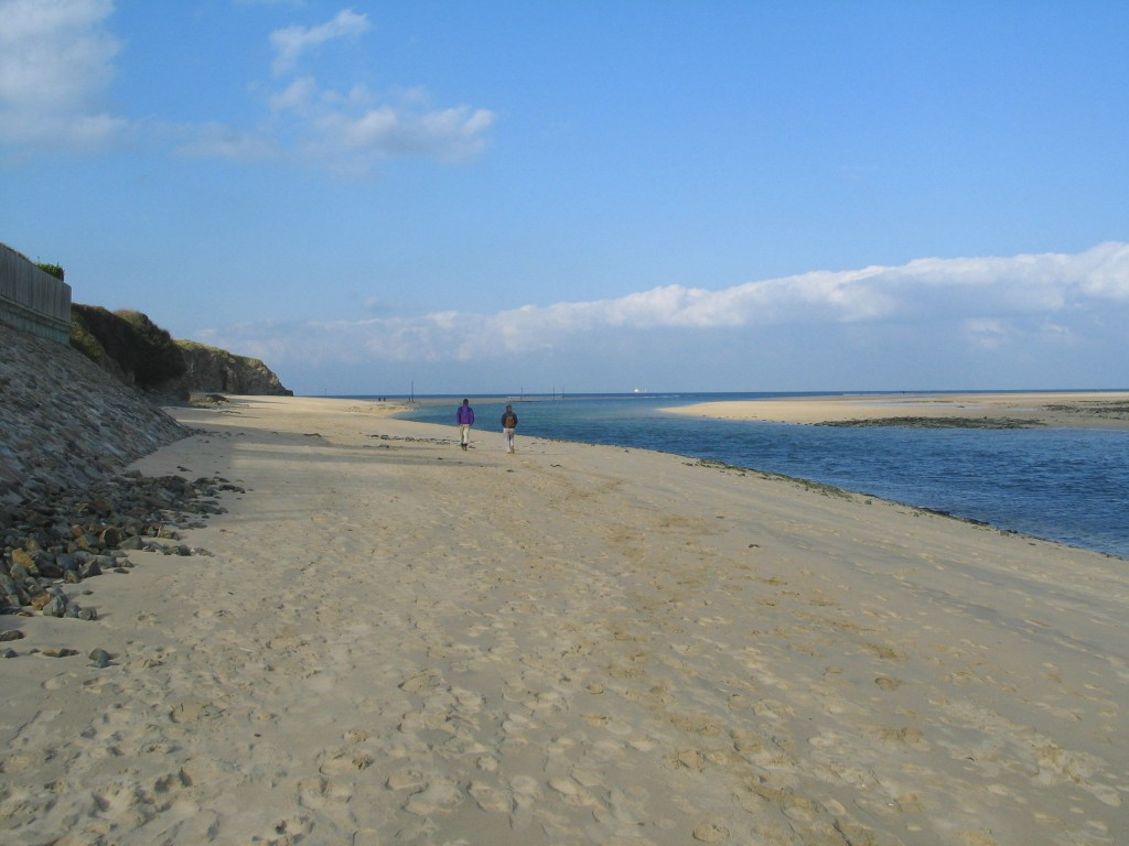 Walking along a sandy Cornish beach