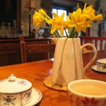 Mug of tea and jug of daffodils