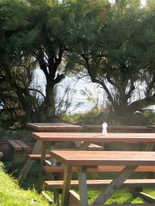 picnic table and chairs above the sea
