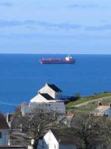 Cornish village and the tanker at sea