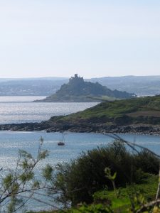 Yathc moored by Perranuthnoe beyond st Michael's Mount