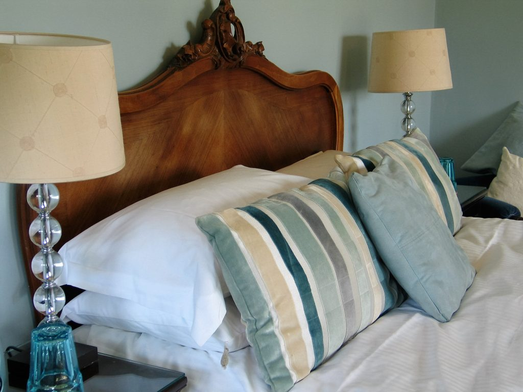 Romantic french bed in a double bedroom ready for new B&B guests