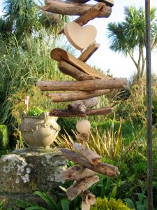 A clever driftwood sculpture became part of the garden dressing
