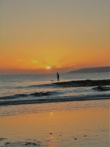 Paddleboarder in the sunset at Perranuthnoe beach