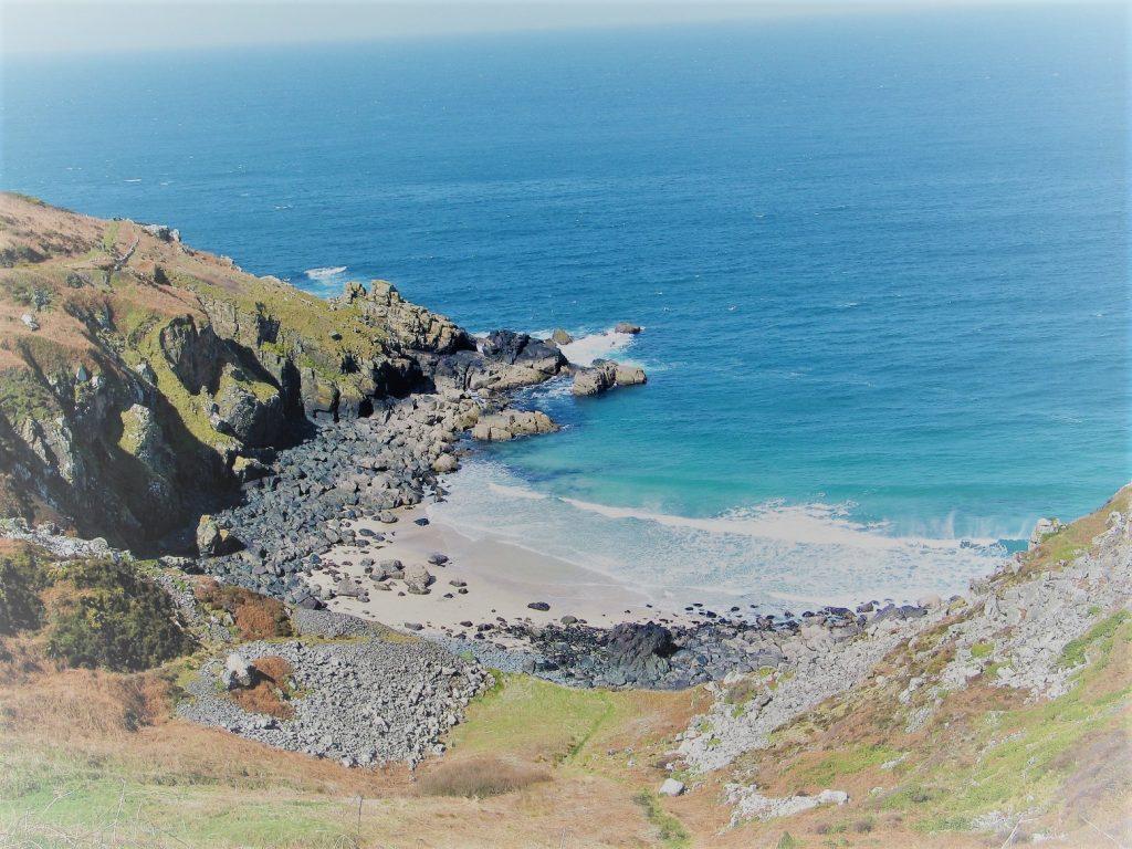 secret unspoilt beach below the coastal footpath