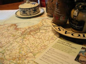 ordinance survey map and leaflets for breakfast plan