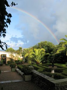 Rainbow arching over garden Parterre