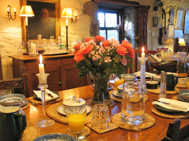 Candles flickering in the breakfast room - Ednovean Farm