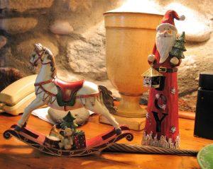 Christmas trinkets on a pine sideboard