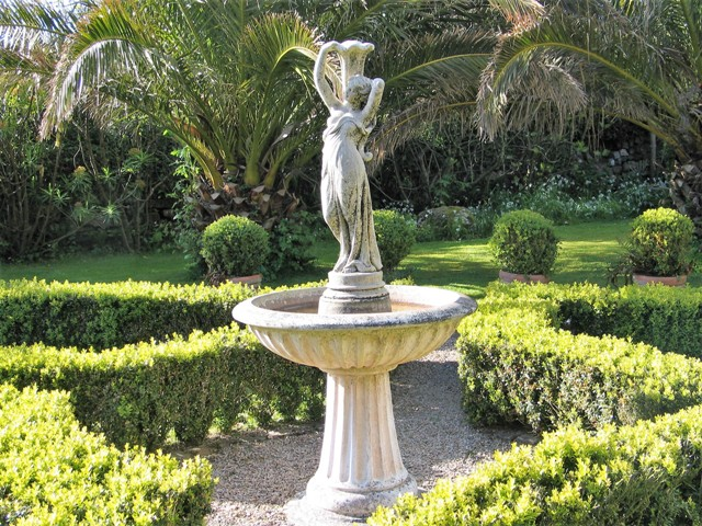 Fountains and formal box in our cornish courtyard formed from a farmyard