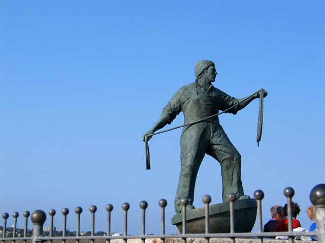 Fisherman's memorial on the sea wall at Newlyn harbour