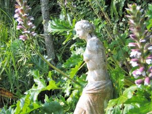 statue in miscanthus flowers