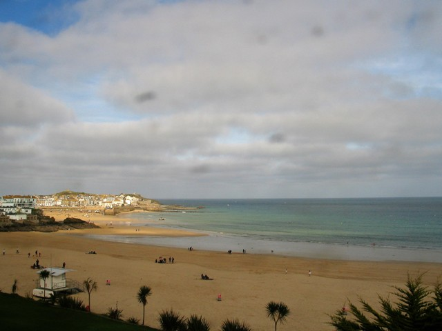 Sandy beach and St ives harbour St Ives train view