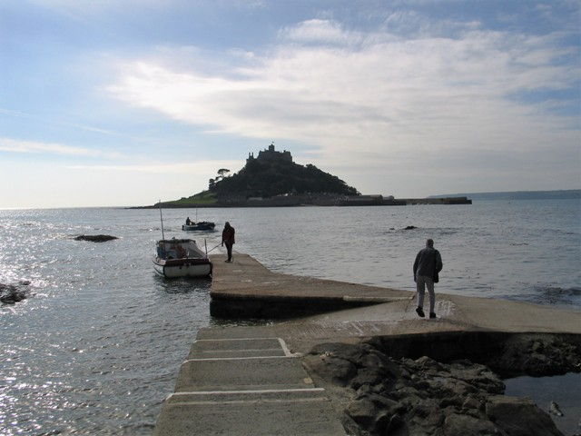 Boat beside landing with St Michael's Mount across the sea