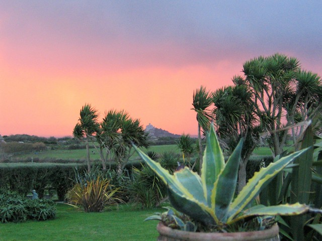 Red sunset sky beyond a garden view to St Michael's Mount - garden dreams