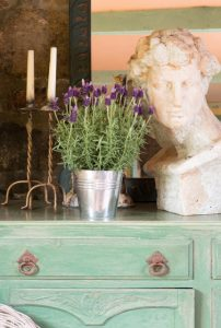 French lavender and stone bust on a sideboard - info facilities