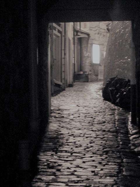 Old alleyway between cottages