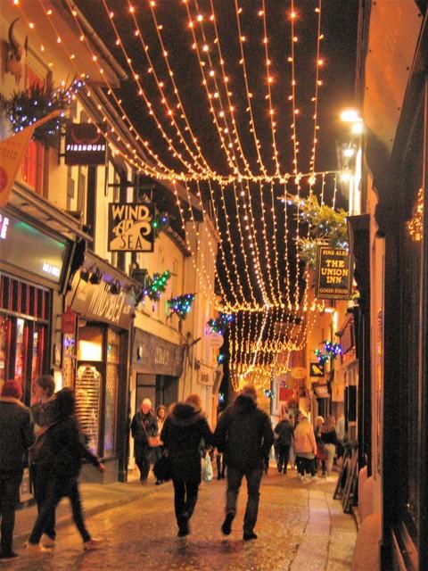 Walkers under christmas lights nostalgic shopping street