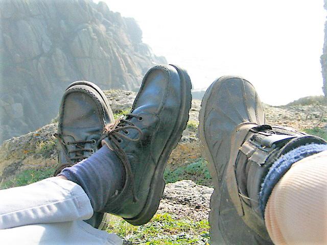 Walkers feet - resting above Logan Rock