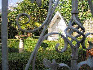 Winter courtyard garden glimpsed though a gate
