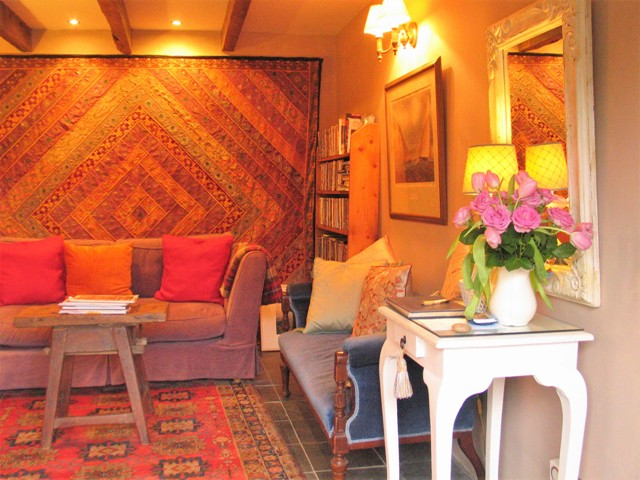 Ships timbers slate floors and persian rugs - guest sitting room