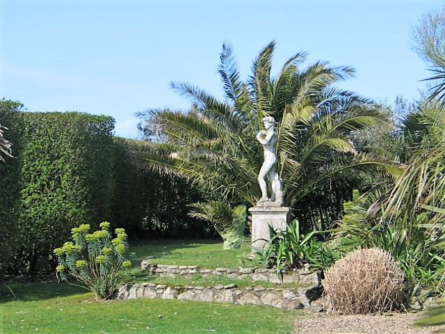 Formal garden with statue and palms - february