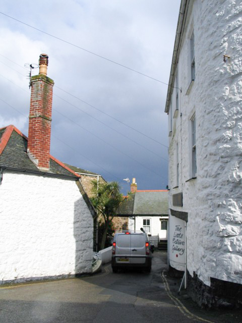 Whitewashed cottages against stormy skies