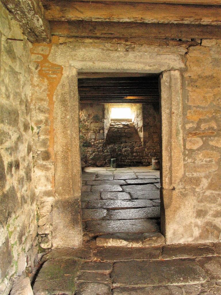 High status stone framed doorway and flagged floors
